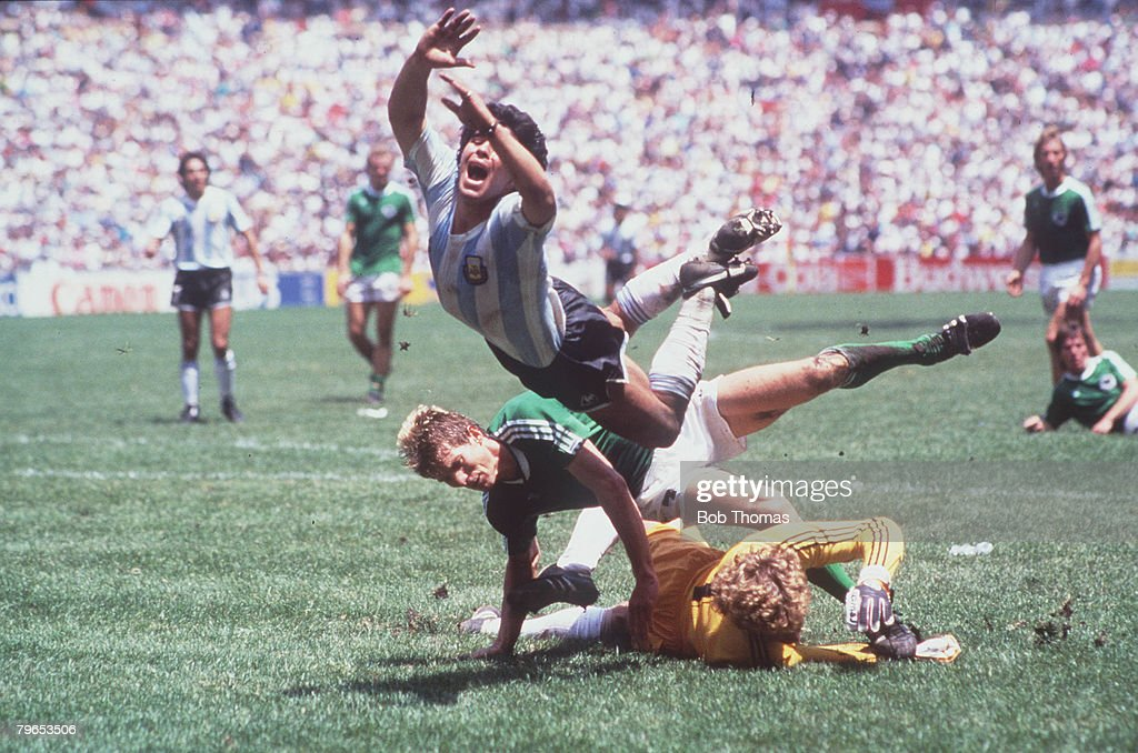1986 World Cup Final, Azteca Stadium, Mexico, 29th June, 1986, Argentina 3 v West Germany 2, Argentina's Diego Maradona goes flying over the challenges of West German goalkeeper Harald Schumacher and defender Karl Heinz Foerster : News Photo