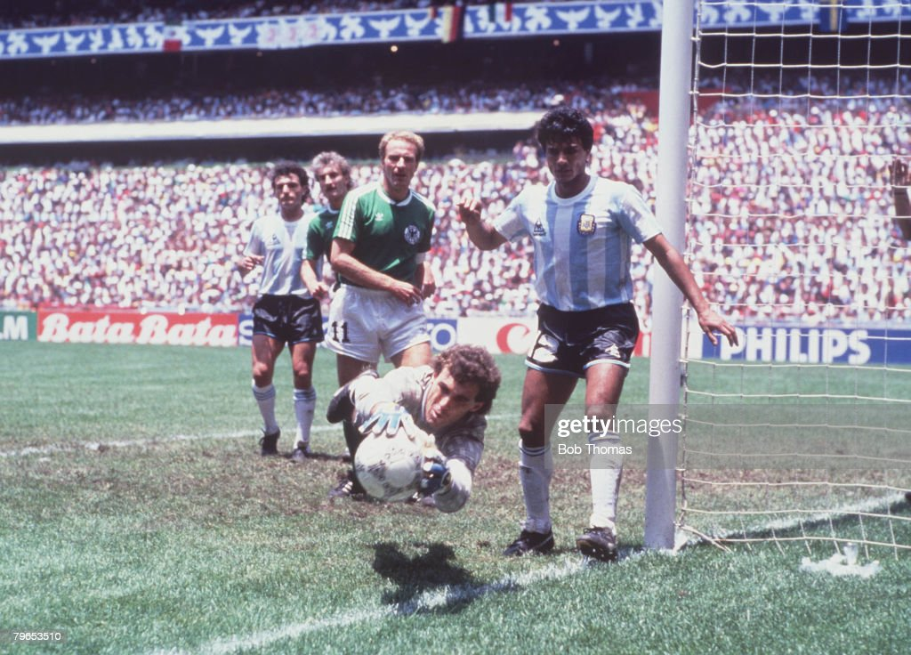 1986 World Cup Final, Azteca Stadium, Mexico, 29th June, 1986, Argentina 3 v West Germany 2, Argentine goalkeeper Nery Pumpido dives to save a West German effort at the foot of the post : News Photo
