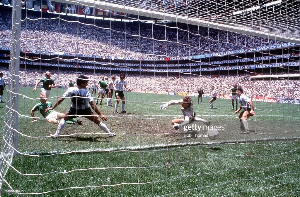 1986 World Cup Final, Azteca Stadium, Mexico, 29th June, 1986, Argentina 3 v West Germany 2, West Germany's Karl Heinz Rummenigge scores West Germany's first goal past Argentina goalkeeper Nery Pumpido to pull the score back to 2-1 : News Photo