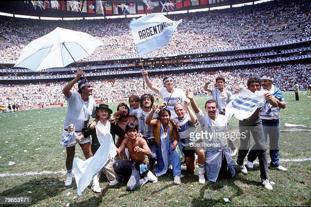 World Cup Final Azteca Stadium Mexico 29th June Argentina 3 v West Germany 2 Excited Argentine fans hold umbrellas and flags in their team's colours...
