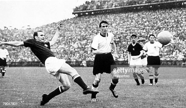 World Cup Final Berne Switzerland 4th July West Germany 3 v Hungary 2 Hungary's Nandor Hideguti at full stretch watched by West German's Horst Eckel
