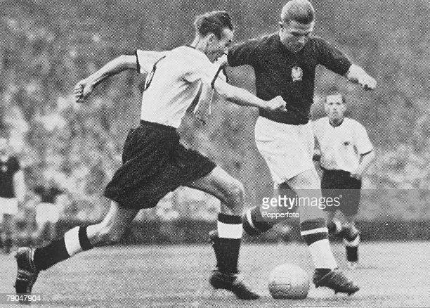 World Cup Final Berne Switzerland 4th July West Germany 3 v Hungary 2 Hungarian captain Ferenc Puskas fights for control of the ball with West...