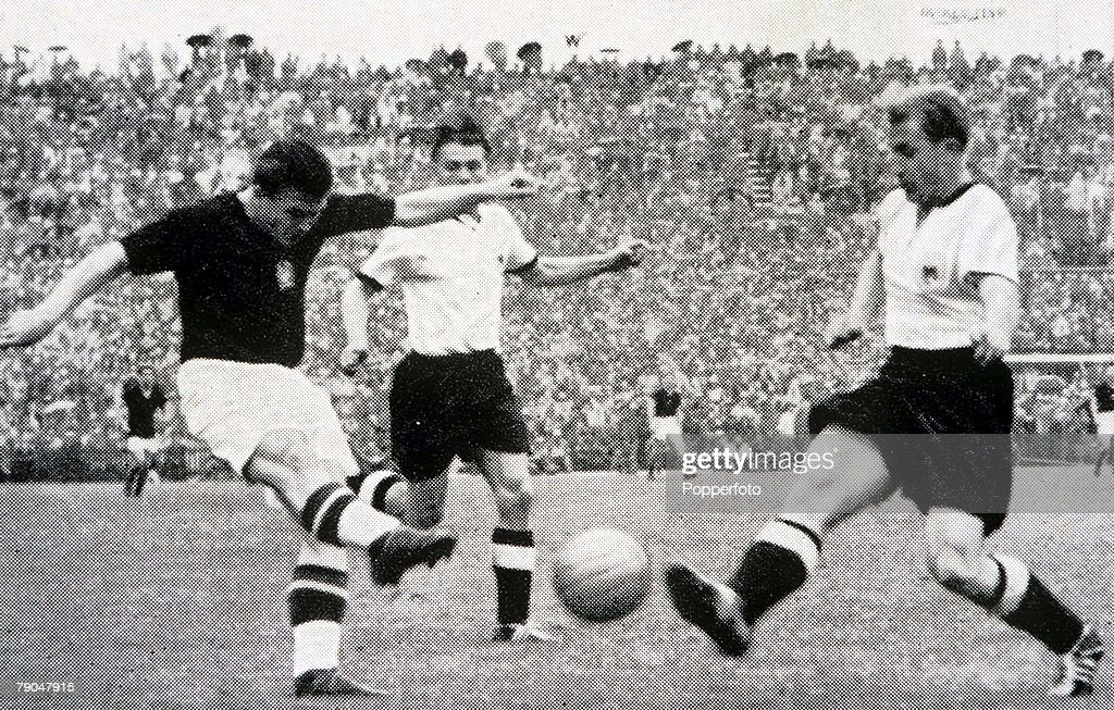 World Cup Final, 1954, Berne, Switzerland, 4th July, 1954, West Germany 3 v Hungary 2, Hungary's captain Ferenc Puskas shoots as West German defender Werner Liebrich challenges
