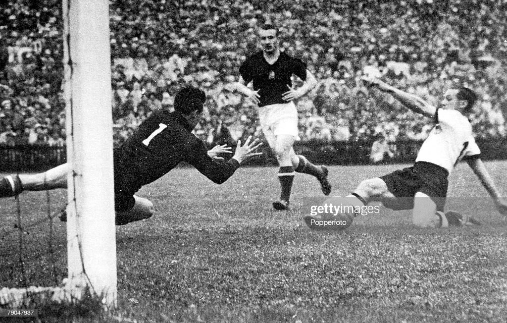 World Cup Final, 1954. Berne, Switzerland. 4th July, 1954. West Germany 3 v Hungary 2. West Germany's Max Morlock slides home his side's first goal past Hungarian goalkeeper Grosics to start their comeback. : News Photo