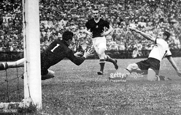 World Cup Final Berne Switzerland 4th July West Germany 3 v Hungary 2 West Germany's Max Morlock slides home his side's first goal past Hungarian...