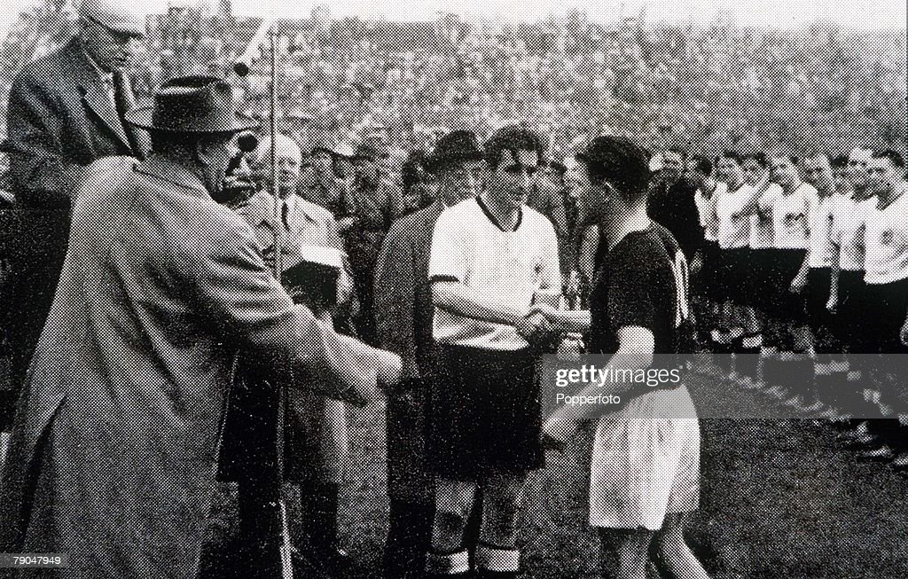 World Cup Final, 1954. Berne, Switzerland. 4th July, 1954. West Germany 3 v Hungary 2. West German captain Fritz Walter receives congratulations from Hungarian captain Ferenc Puskas after the match. : News Photo