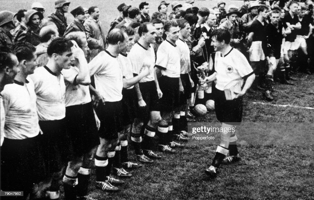 World Cup Final, 1954. Berne, Switzerland. 4th July, 1954. West Germany 3 v Hungary 2. West German captain Fritz Walter shows off the World Cup trophy to his teammates after their win. : News Photo
