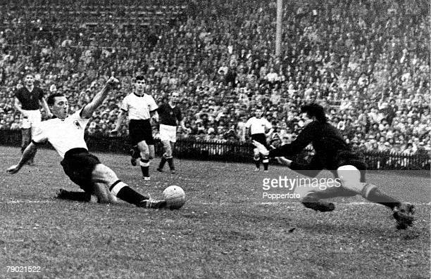 World Cup Final BernSwitzerland 4th July 1954 West Germanyv Hungary West Germany's Max Morlock stretches to beat Hungary goalkeeper Gyula Grosics and...
