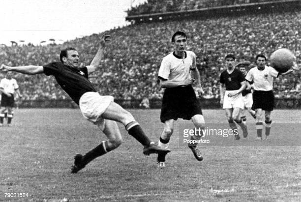 World Cup Final BernSwitzerland 4th July 1954 West Germanyv Hungary Hungary forward Nandor Hidegkuti fires in a shot as West Germany's Horst Eckel...