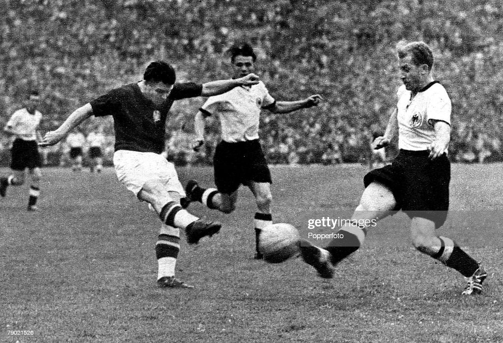 1954 World Cup Final. Bern,Switzerland. 4th July 1954. West Germany.3.v Hungary.2. Hugary captain Ferenc Puskas fires in a shot as West Germany's Werner Liebrich tries to block. : News Photo