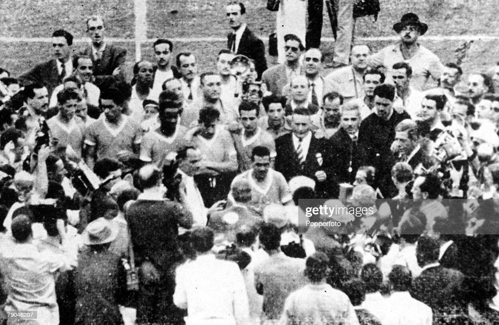World Cup Final, 1950. Brazil. Maracana Stadium, Rio De Jainero. Brazil 1 v Uruguay 2. 16th July, 1950. Chaotic scenes as FIFA President Jules Rimet presents the World Cup trophy to Uruguayan captain Varella. : News Photo