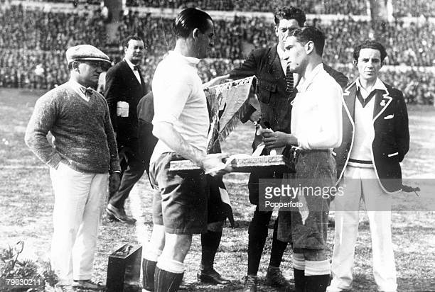 World Cup Final Montevideo Uruguay Uruguay 4 v Argentina 2 Uruguay's captain Jose Nasazzi shakes hands with Argentine captain Manuel Ferreira before...