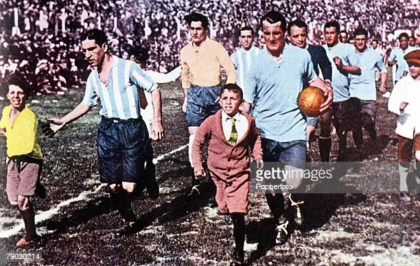 World Cup Final Montevideo Uruguay Uruguay 4 v Argentina 2 Uruguay's veteran captain Jose Nasazzi and Argentine captain Manuel Ferreira lead their...