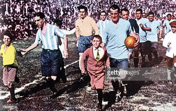 World Cup Final Montevideo Uruguay Uruguay 4 v Argentina 2 Uruguay's veteran captain Jose Nasazzi and Argentine captain Manuel Ferreira lead their...