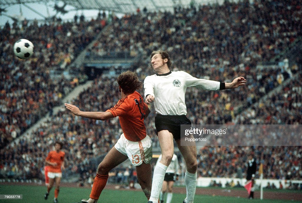 1974 World Cup Final. Munich, West Germany. 7th July, 1974. West Germany 2 v Holland 1. West Germany's Hans Wolf Swarzenbeck heads the ball clear from Holland's Johan Neeskens. : News Photo