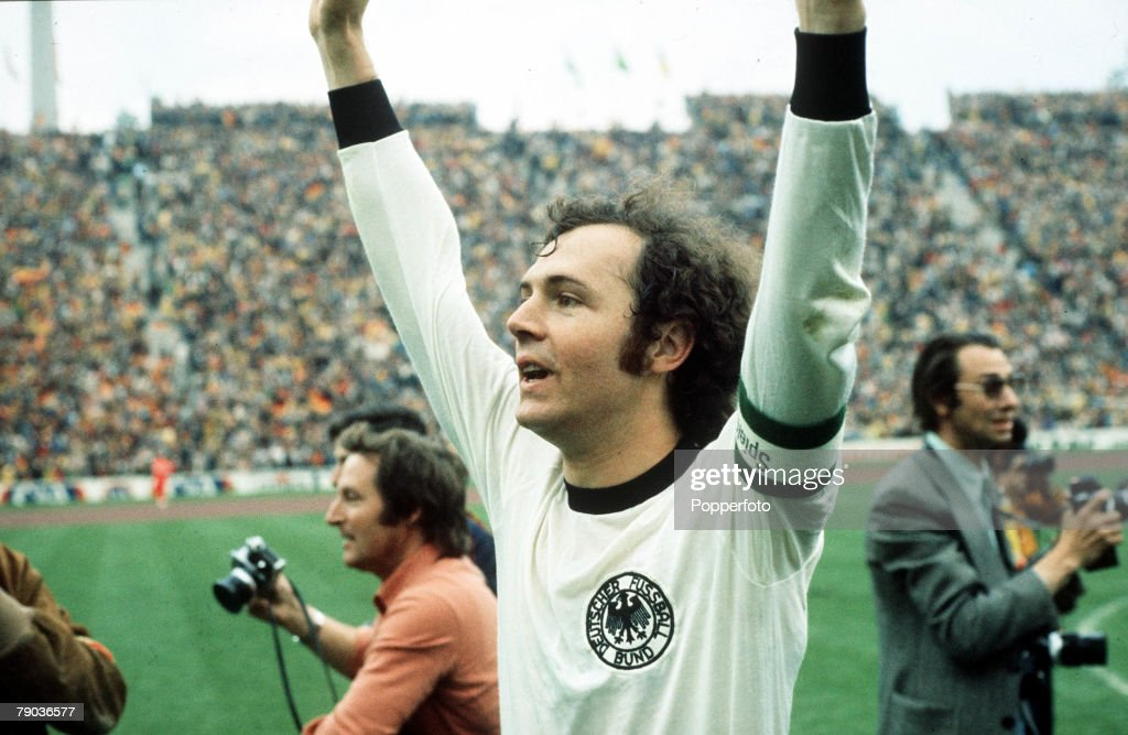 1974 World Cup Final. Munich, West Germany. 7th July, 1974. West Germany 2 v Holland 1. West German captain Franz Beckenbauer raises his arms in celebration as they become World Champions for the second time in history. : News Photo