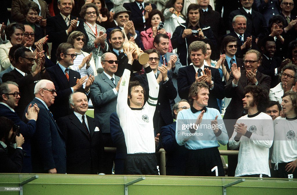 1974 World Cup Final. Munich, West Germany. 7th July, 1974. West Germany 2 v Holland 1. West German captain Franz Beckenbauer holds aloft the trophy as his team become World Champions for the second time in history. : News Photo