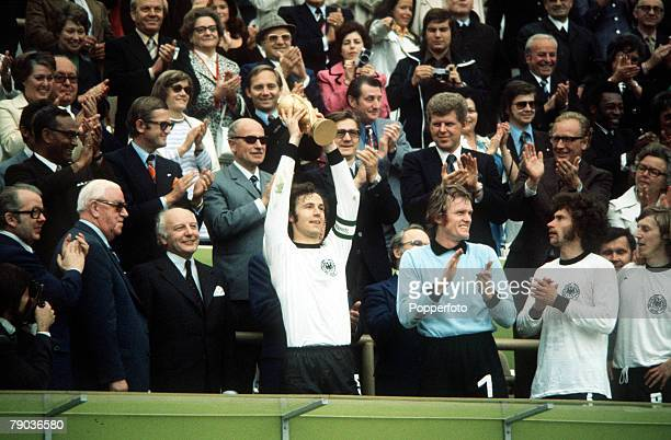 World Cup Final Munich West Germany 7th July West Germany 2 v Holland 1 West German captain Franz Beckenbauer holds aloft the trophy as his team...