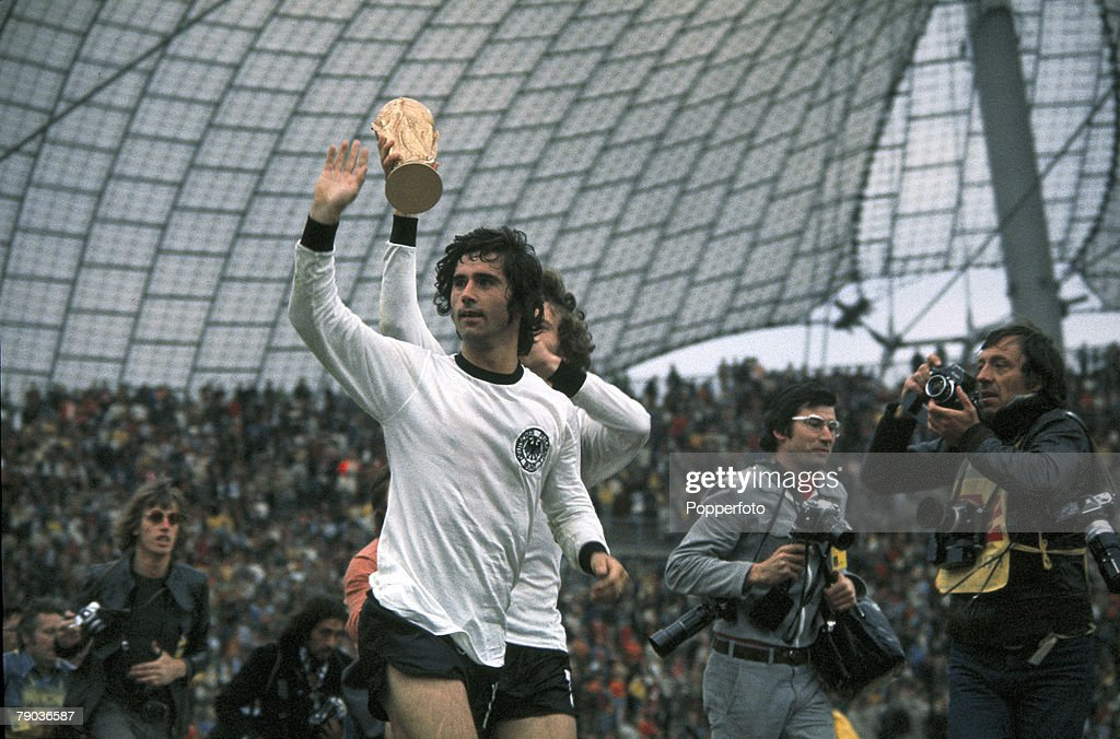 1974 World Cup Final. Munich, West Germany. 7th July, 1974. West Germany 2 v Holland 1. West Germany's Gerd Muller, scorer of the winning goal, waves to the crowd as the team parade the trophy on a lap of honour after the match. : News Photo