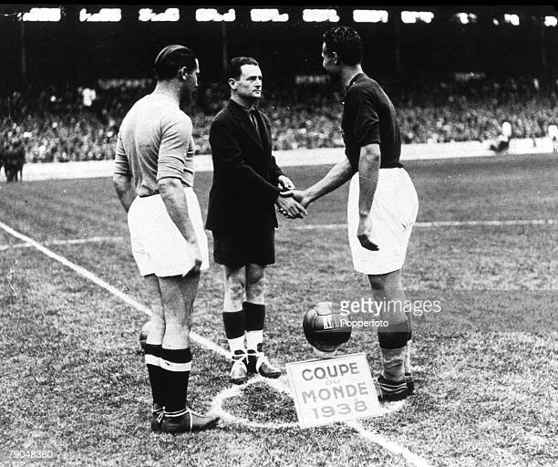 World Cup Final Paris France Italy 4 v Hungary 2 19th June 1938 Italian captain Giuseppe Meazza looks on as referee George Capdeville shakes hands...