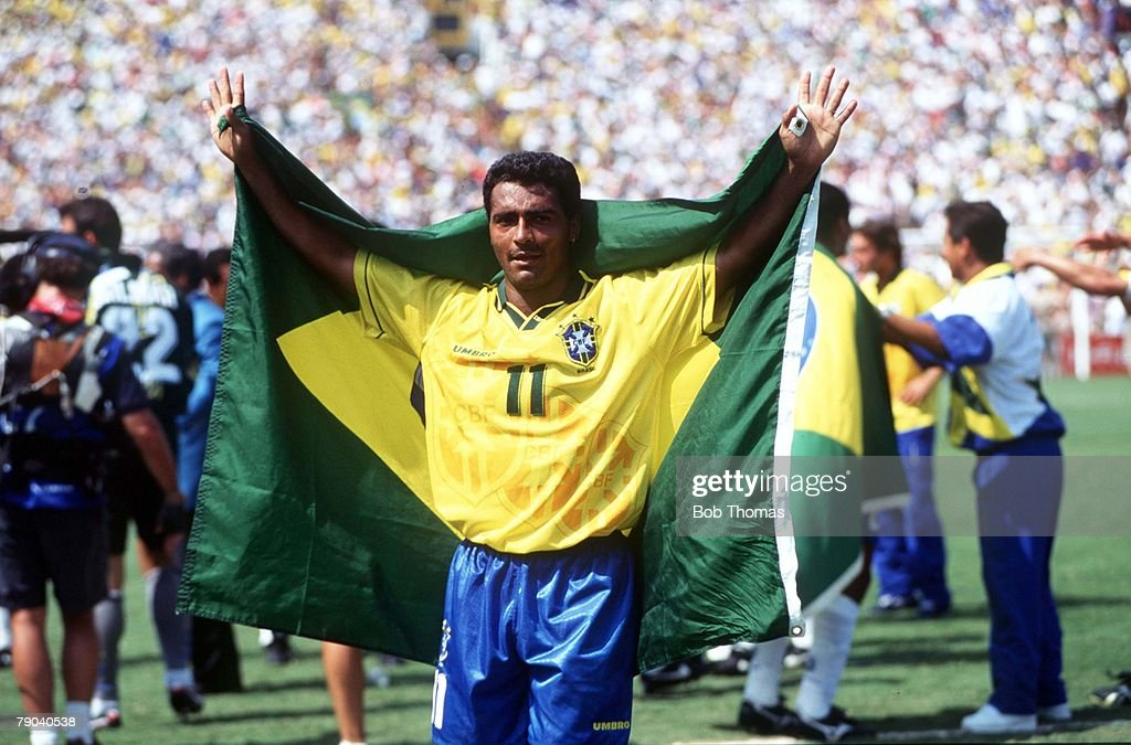 1994 World Cup Final. Pasadena, USA. 17th July, 1994. Brazil 0 v Italy 0. (Brazil won 3-2 on penalties). Brazilian star Romario drapes himself in his country's flag after Brazil won the World Cup by beating Italy on penalties. : News Photo