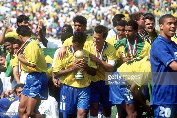 World Cup Final, Pasadena, USA, 17th July Brazil 0 v Italy 0, , Brazil's Romario kisses the World Cup trophy embraced by captain Dunga as Brazil...