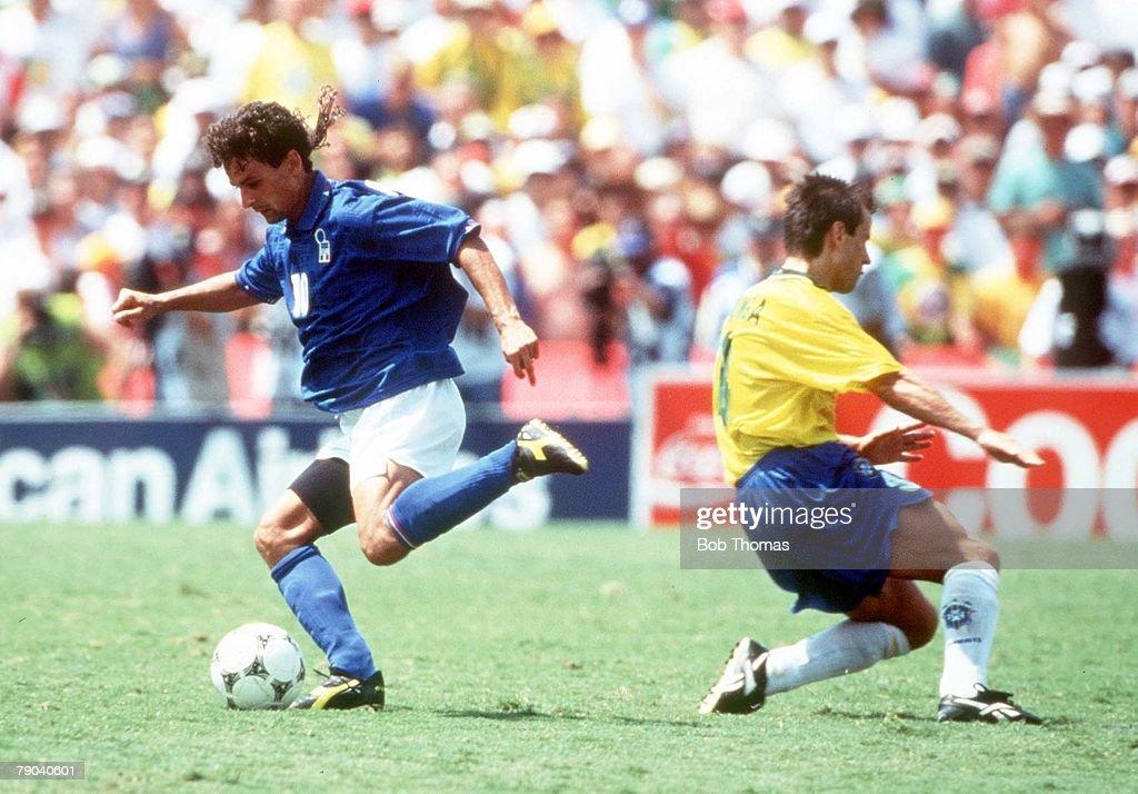 1994 World Cup Final. Pasadena, USA. 17th July, 1994. Brazil 0 v Italy 0. (Brazil won 3-2 on penalties). Italy's Roberto Baggio beats Brazil's Dunga. : News Photo