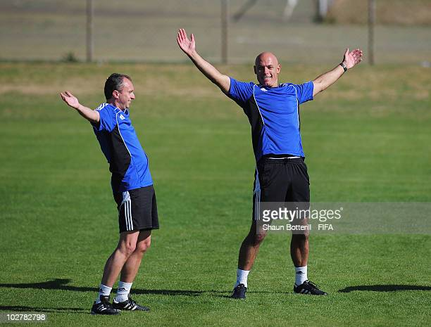 World Cup Final referee Howard Webb warms up with his assistant Darren Cann during a training session at the Final Referee's Media Day for the 2010...
