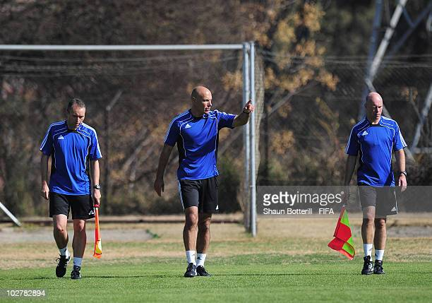 World Cup Final referee Howard Webb warms up with his assistants Darren Cann and Michael Mullarkey during a training session at the Final Referee's...