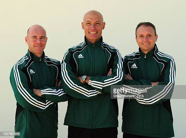 World Cup Final referee Howard Webb with his assistants Darren Cann and Michael Mullarkey pose for a photo at the referee's hotel on July 10 2010 in...