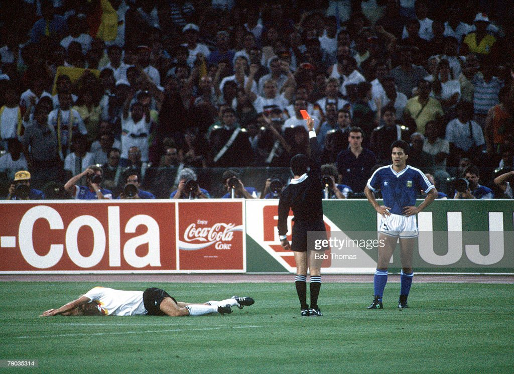 1990 World Cup Final. Rome, Italy. 8th July, 1990. West Germany 1 v Argentina 0. Argentina's Pedro Monzon is sent off by the referee after fouling West Germany's Jurgen Klinsmann (left). : News Photo