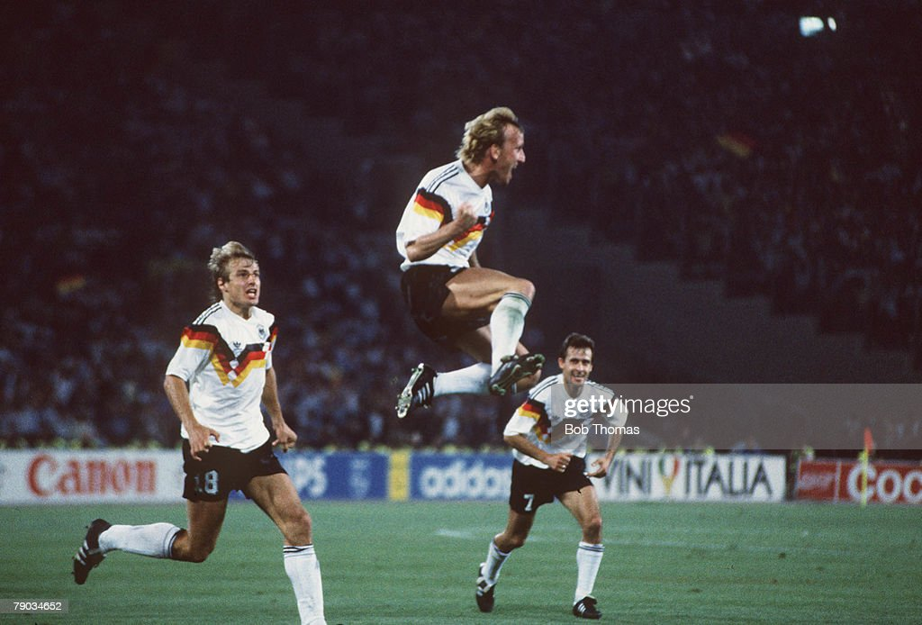 1990 World Cup Final. Rome, Italy. 8th July, 1990. West Germany 1 v Argentina 0. West Germany's Andreas Brehme leaps for joy after scoring the only goal from the penalty spot to win the World Cup for West Germany as teammate Jurgen Klinsmann (left) runs i : News Photo