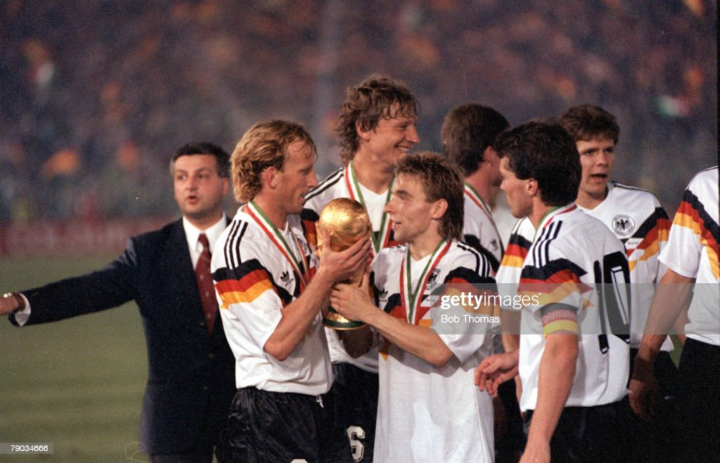 World Cup Final, Rome, Italy, 8th July, 1990, West Germany 1 v Argentina 0, West Germany's Thomas Hassler holds the World Cup trophy with Andreas Brehme after the presentation
