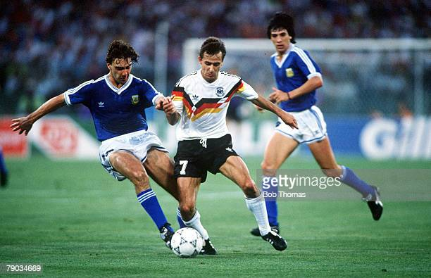 World Cup Final, Rome, Italy, 8th July West Germany 1 v Argentina 0, West Germany's Pierre Littbarski is challenged for the ball by Argentina's...