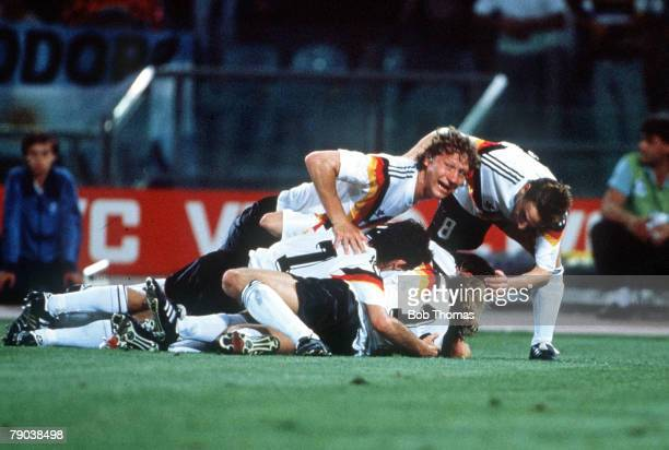 World Cup Final Rome Italy 8th July West Germany 1 v Argentina 0 West German palyers mob grounded Andreas Brehme as they celebrate his goal from the...