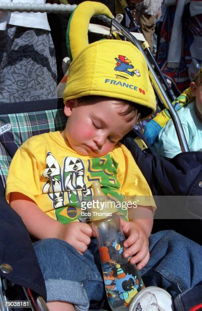 World Cup Final St Denis France 12th July France 3 v Brazil 0 A young Brazilian fan dressed in the colours but fast asleep