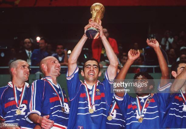 World Cup Final St Denis France 12th July France 3 v Brazil 0 France's Youri Djorkaeff lifts the World Cup trophy as teammates Candela Leboeuf and...