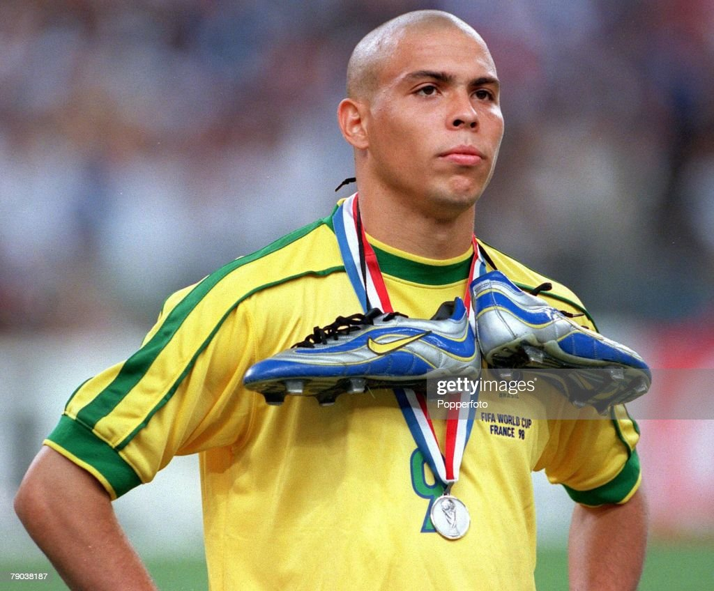 1998 World Cup Final. St. Denis, France. 12th July, 1998. France 3 v Brazil 0. Brazil's Ronaldo stands dejected at the end with silver boots and silver medal . : News Photo