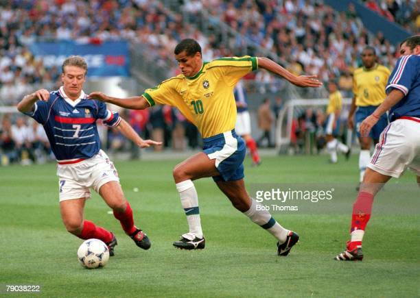 World Cup Final St Denis Paris France 12th July France 3 v Brazil 0 Brazil's Rivaldo races away with the ball as France's Didier Deschamps challenges