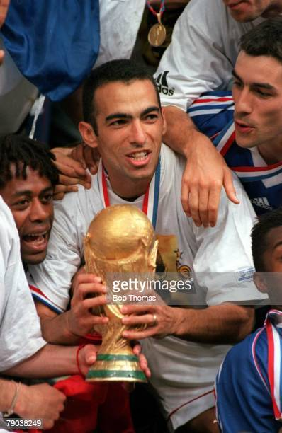 World Cup Final St Denis France 12th July France 3 v Brazil 0 France's Youri Djorkaeff holds the World Cup trophy during celebrations after the match