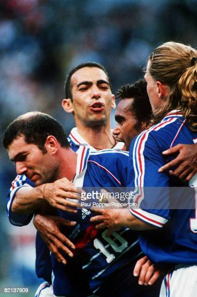 World Cup Final, St Denis, Paris, France, 12th July France 3 v Brazil 0, France's Zinedine Zidane after scoring the first goal with team-mates Petit,...