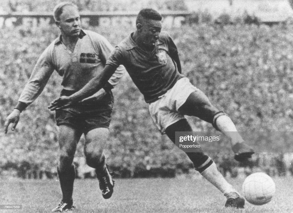 1958 World Cup Final. Stockholm, Sweden. 29th June, 1958. Sweden 2 v Brazil 5. Brazil's Pele shoots as he is challenged by a Swedish defender. : News Photo