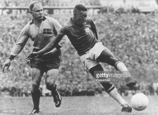 World Cup Final Stockholm Sweden 29th June Sweden 2 v Brazil 5 Brazil's Pele shoots as he is challenged by a Swedish defender