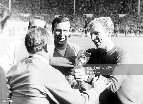 World Cup Final Wembley England 30th July 1966 England 4 v West Germany 2 England's captain Bobby Moore passes the World Cup trophy to manager Alf...