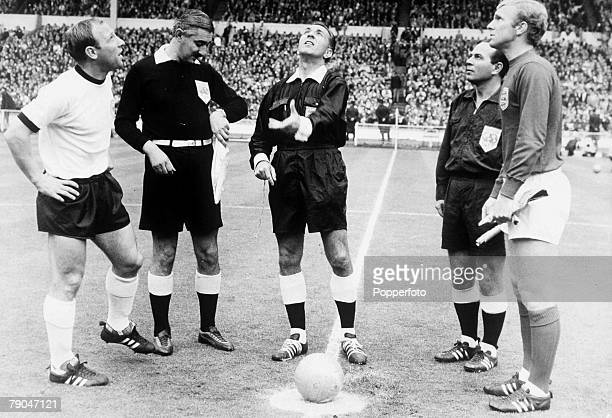 World Cup Final Wembley, England, 30th July, 1966 England 4 v West Germany 2, England captain Bobby Moore and West German captain Uwe Seeler watch as...
