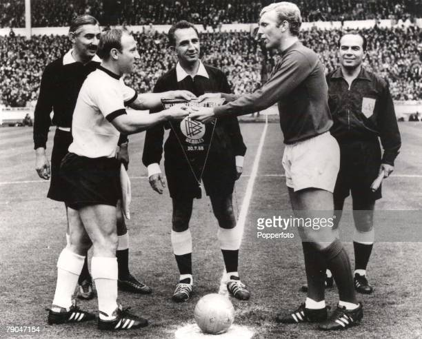 World Cup Final Wembley England 30th July 1966 England 4 v West Germany 2 West German captain Uwe Seeler exchanges pennants with England's captain...