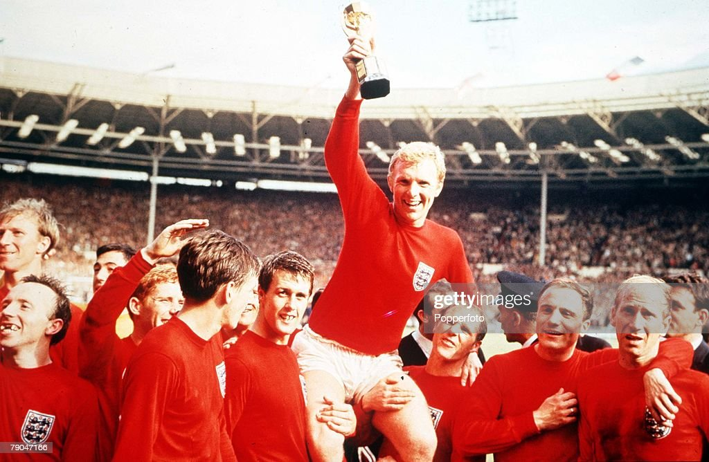 World Cup Final, 1966. Wembley, England. 30th July, 1966 England 4 v West Germany 2. Englands captain Bobby Moore holds aloft the Jules Rimet World Cup trophy as he sits on the shoulders of his teammates after the match. : News Photo