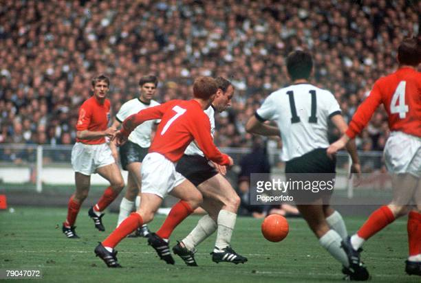 World Cup Final, Wembley Stadium, England, 30th July England 4 v West Germany 2, England's Alan Ball ball chases West Germany's Uwe Seeler as...