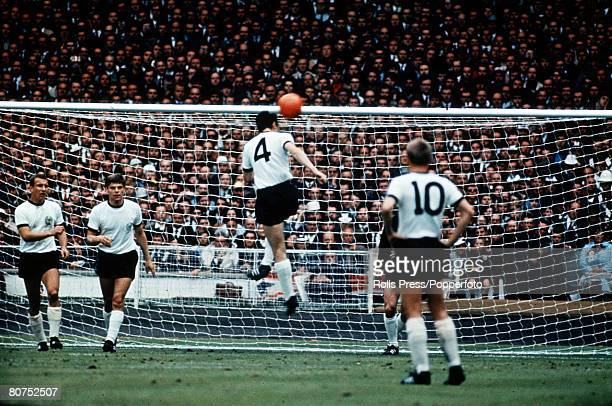 World Cup Final Wembley Stadium England 30th July England 4 v West Germany 2 West Germany's Franz Beckenbauer clears an England shot with his head in...
