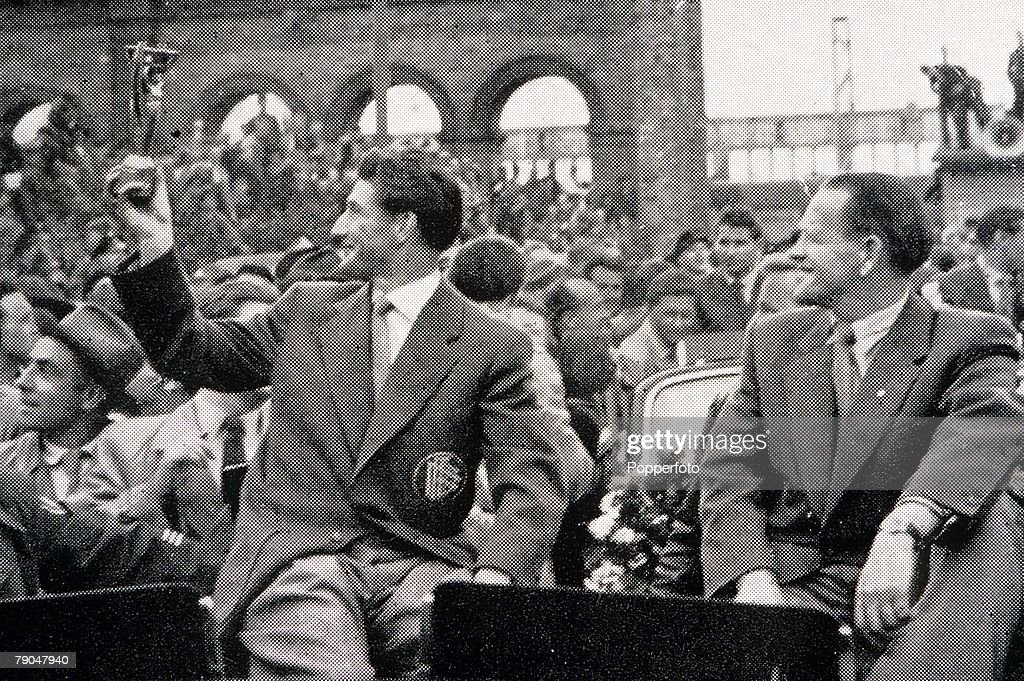World Cup Finals 1954. Switzerland. West German captain Fritz Walter, with the World Cup, and coach Sepp Herberger arrive in Munich after winning the World Cup. : News Photo